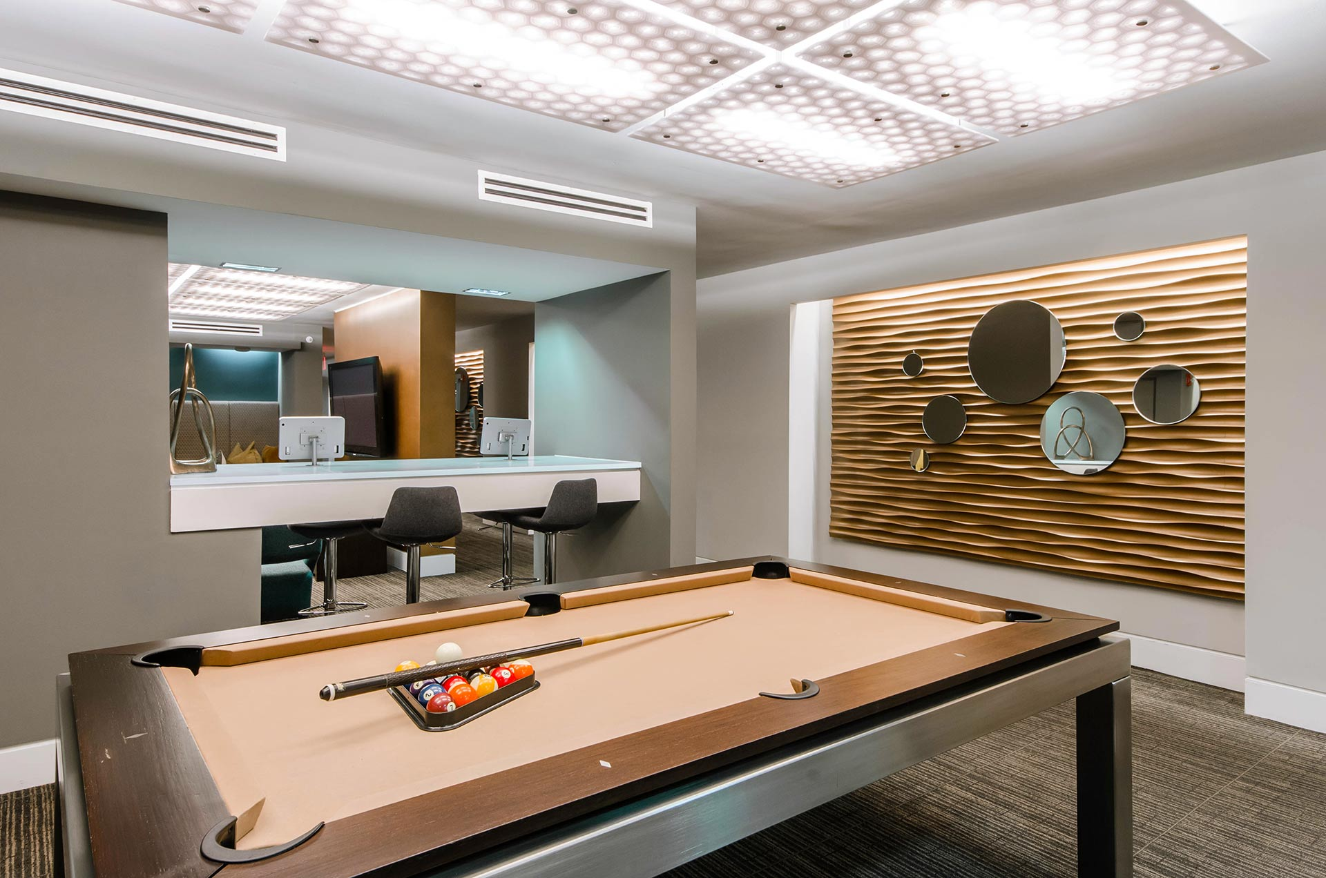Clubroom nook with pool table and computer bar in the background