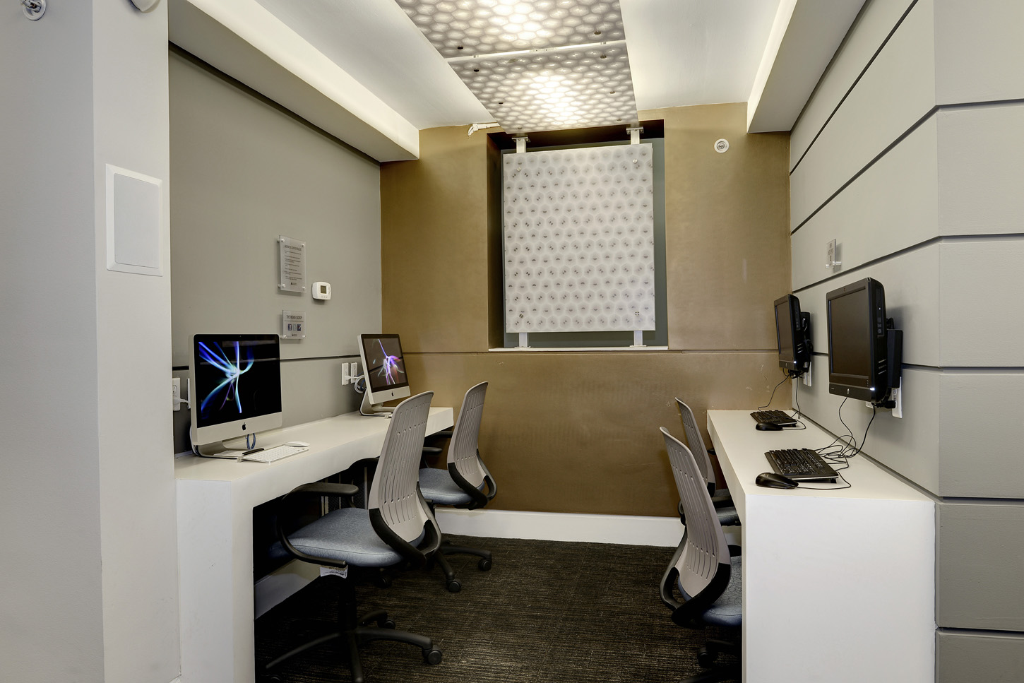 Clubroom nook with iMac and PC computer stations