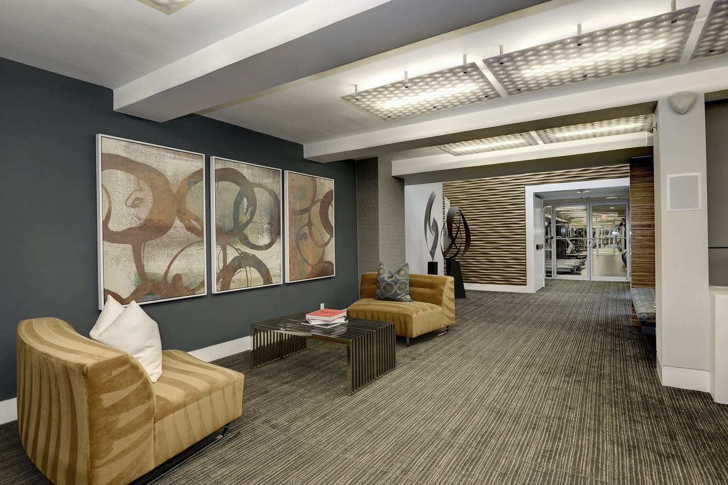 Clubroom hallway with armchairs and abstract art