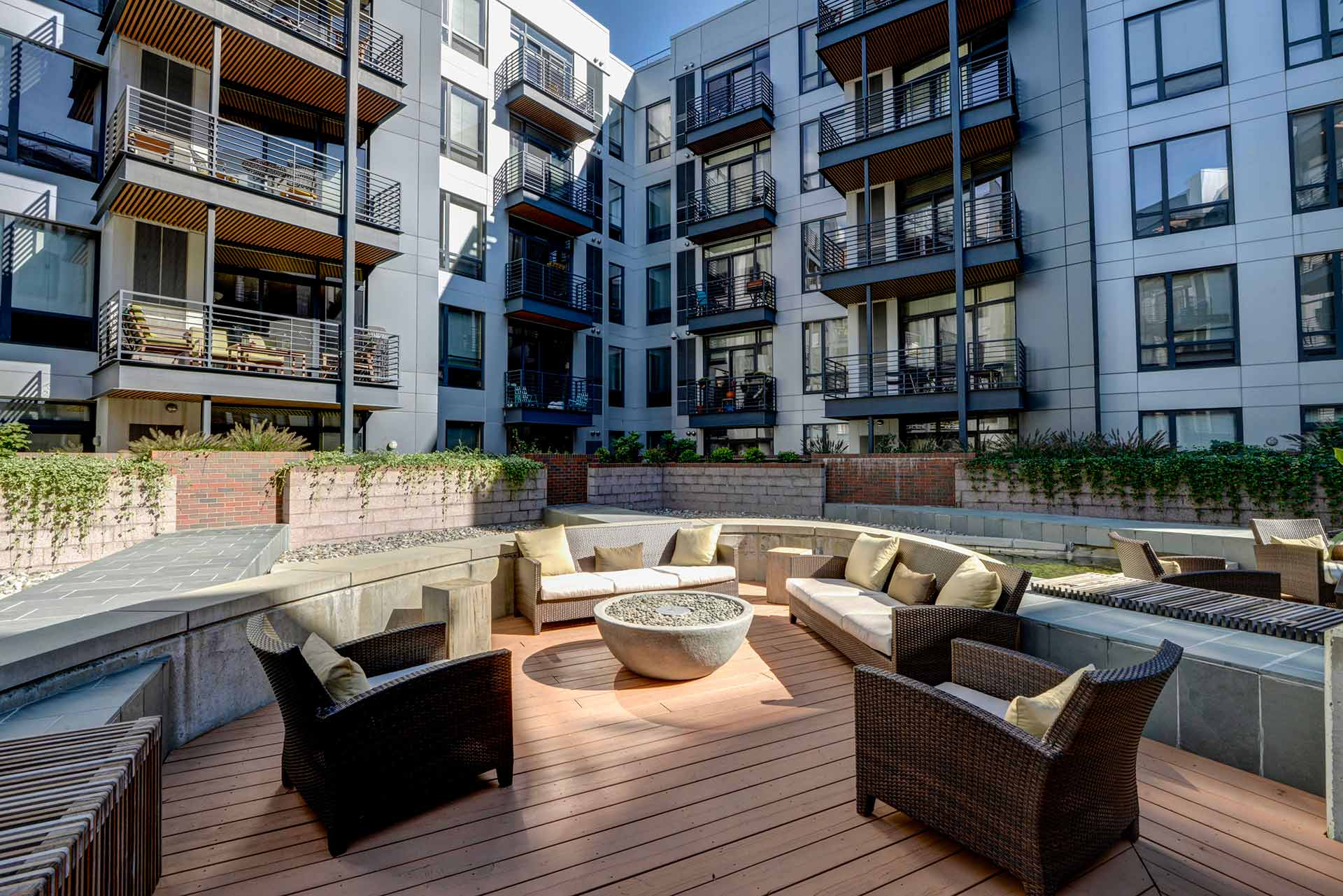 Interior courtyard closeup of lounge seating in the afternoon sunlight and view of surrounding multi-storied balconies