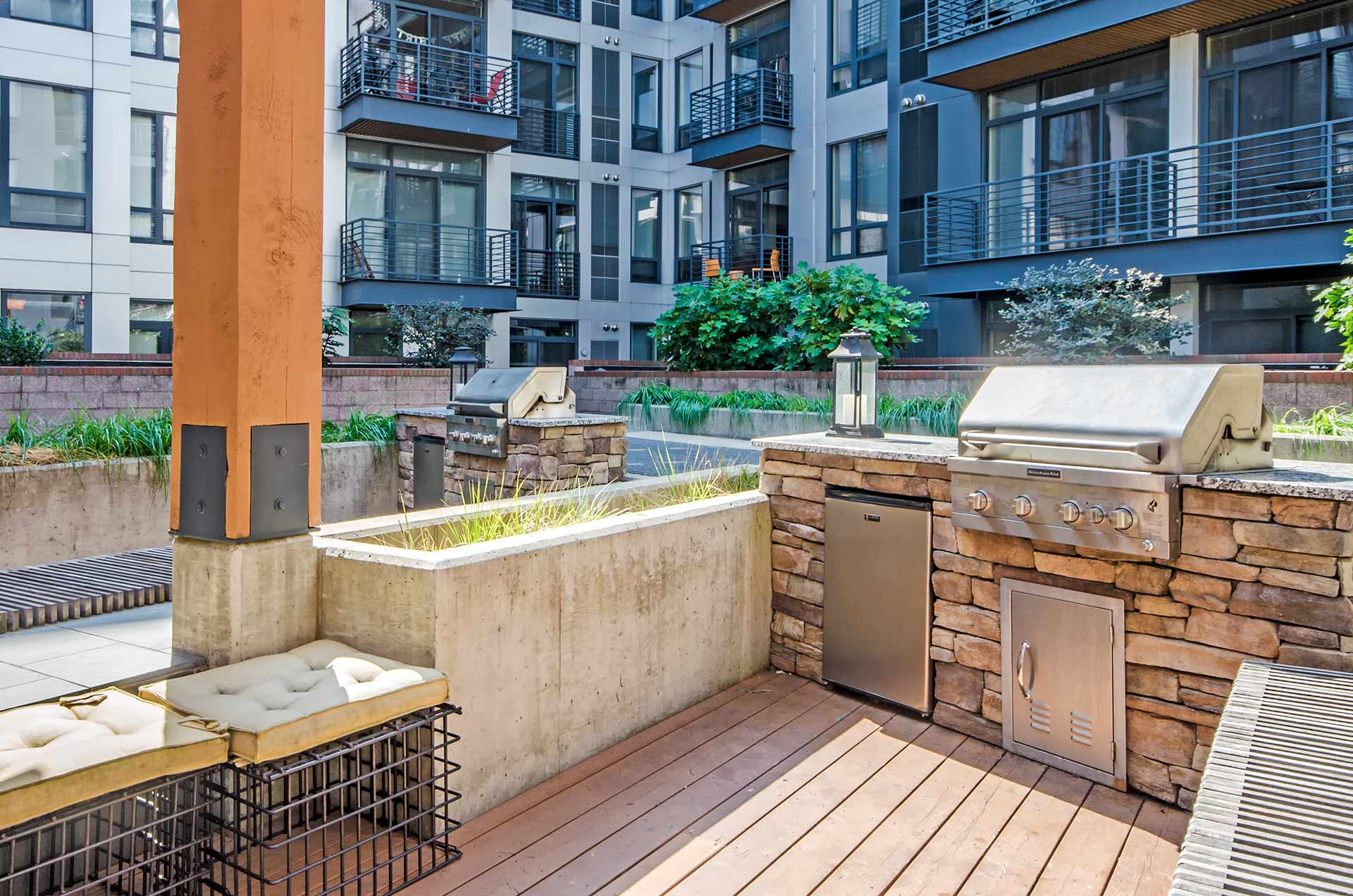 Interior courtyard closeup of grilling stations with nearby bench seating